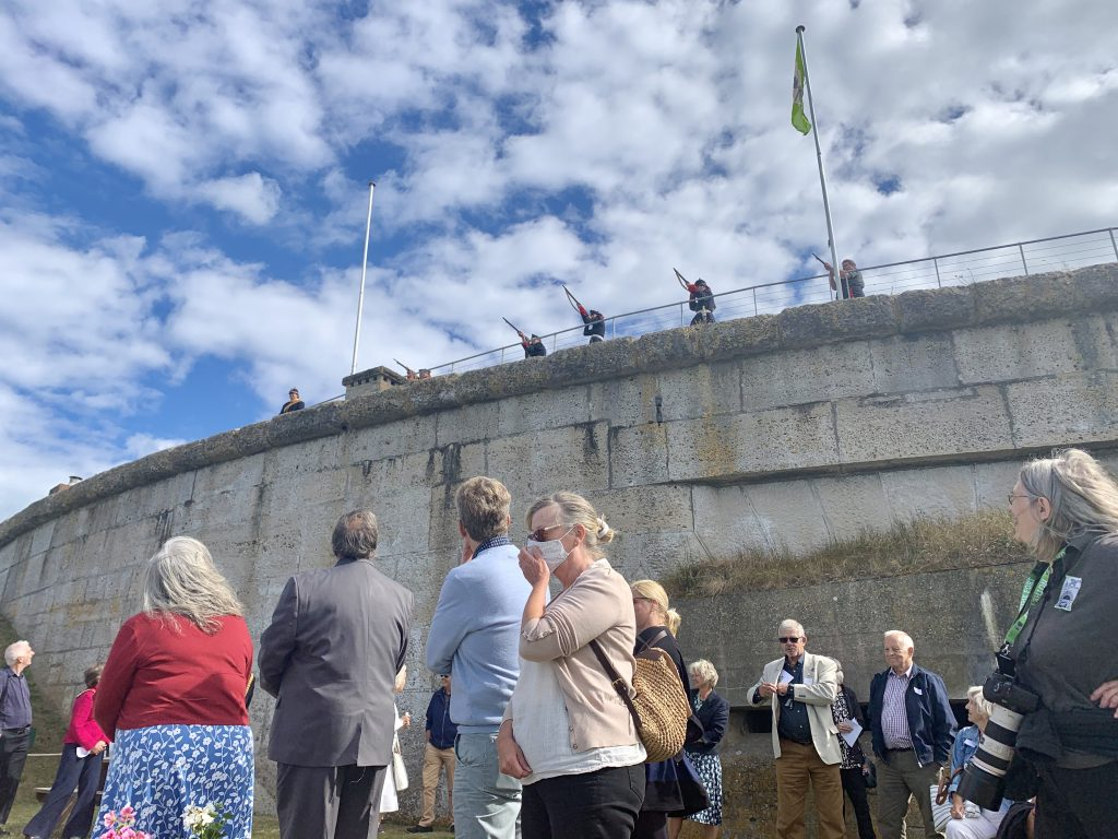 Ceremonial shots are fired from the ramparts to mark the unveiling of the north terrace and the two carved slate panel benches by Stoneform.