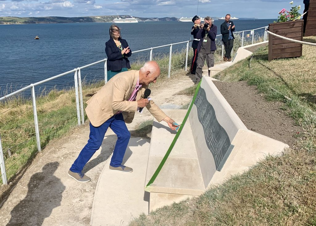 Paul Atterbury - Bounce Back Director - cuts the ribbon to unveil the benches and enhanced north terrace of the Nothe Fort